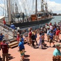 People boarding sailing ship, Elissa, in Galveston.