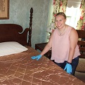Sam Rayburn House State Historic Site intern Cortney Smith with the Wholecloth Quilt.