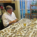 Archeologist working with artifacts