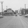 South Laredo Street at South Santa Rosa Street, May 1962. Casa Navarro and the new Bexar County jail are visible in the background. Photo courtesy of UTSA Special Collections.