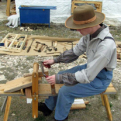 Reenactor using the shave horse