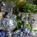 Silver pitcher and goblets.