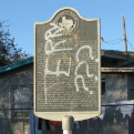 Historical marker with graffiti
