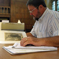 Moore researching at Yale's Beinecke Library.