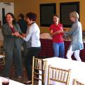 "Workshop attendees in Laredo dance ""Cumbia"""