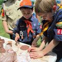 Boy scouts make pinch pots. Photo by Debbie Burkett.