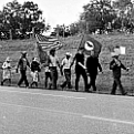Farm workers march along a South Texas roadway
