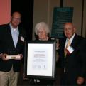 Recipients accept the Governor's Award.