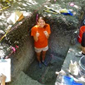 Photo of former diversity intern working in the field at an archeological site.