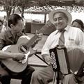 Hispanic men playing musical instruments.