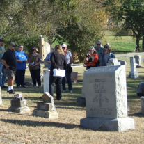 Visitors listen to a story during the Cemetery Walking Tour