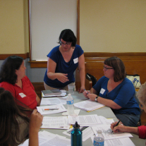 Image of Erin MacEntee leading museum workshop participants through a workshkop activity.
