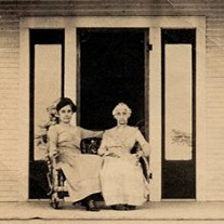 Photograph of Lucinda Rayburn and Martha Rayburn on the front porch of the Sam Rayburn House, circa 1916