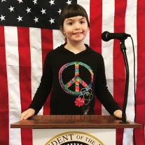 A girl poses at our Presidential Podium.
