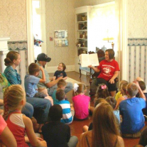 Felicia Maden, Youth Services Manager at the Marshall Public Library, reads and exciting story to an excited audience.