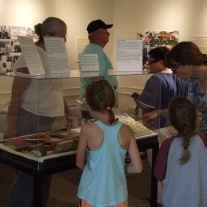 Visitors to the Quilt Hop at the SRH view sewing artifacts