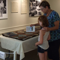 Visitors view Log Cabin quilt at the Sam Rayburn House