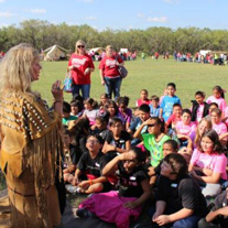 A school group listens to a speaker during Fort Griffin's Living History Days.