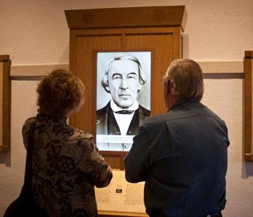 Visitors view an exhibit.