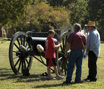 Visitors learn about the Old Val Verde cannon.