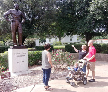 Visitors view the Eisenhower statue.