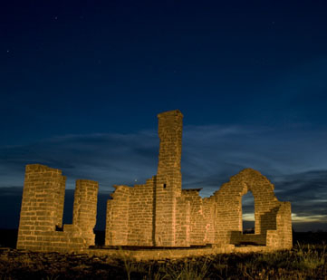 The fort ruins at night.