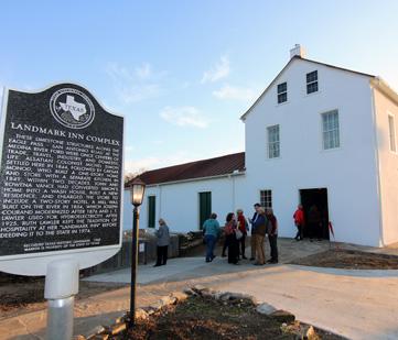 Landmark Inn's exterior and historical marker.