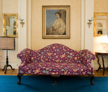 Period sofa and portrait.