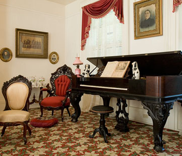 Interior room with grand piano.