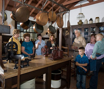 A tour group visits the kitchen.